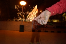 Light up a match stick, click with a flash and keep the shutter open for few seconds longer.