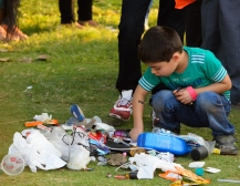 A gathering of crap, and a kid sorting it.